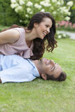 Playful young couple having leisure time in park Stock Image