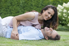 Playful young couple having leisure time in park Royalty Free Stock Images