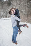 Playful young couple outdoors in winter Stock Photos
