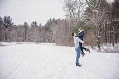 Playful young couple outdoors in winter royalty free stock images