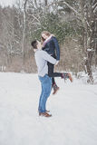 Playful young couple outdoors in winter royalty free stock photography