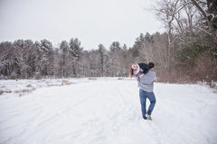 Playful young couple outdoors in winter stock photo