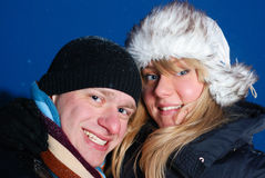 Playful young couple at winter evening Royalty Free Stock Images