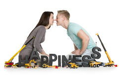 Playful young couple with word happiness. Royalty Free Stock Photos
