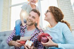 Playful Young Family in Sunlight royalty free stock photo