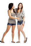 Playful young females on white background Royalty Free Stock Image
