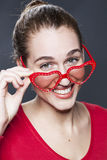 Playful young girl with red glasses for fun love Stock Photography