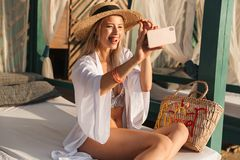 Playful young girl in summer hat and swimwear Stock Photos