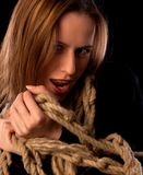 Playful young girl tied in ropes Stock Photos