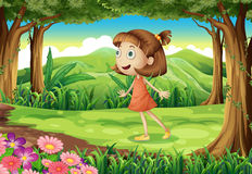 A playful young girl at the woods Royalty Free Stock Images