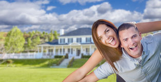 Playful Young Military Couple Outside Beautiful Home royalty free stock images