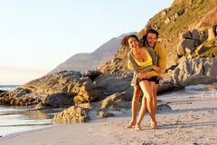 Playful young mixed race couple at the beach Stock Photos