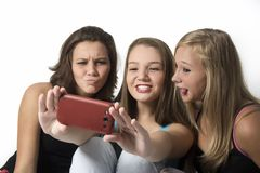 Playful Young Teenager Girls doing a group selfie Stock Image