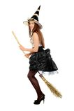Playful young woman with a besom Stock Photo