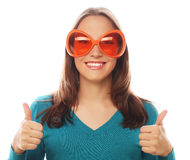 Playful young woman with big party glasses. Royalty Free Stock Photos