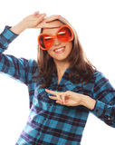 Playful young woman with big party glasses. Stock Image