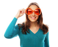 Playful young woman with big party glasses. Stock Photo