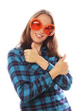 Playful young woman with big party glasses. Royalty Free Stock Photo