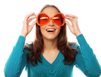 Playful young woman with big party glasses. Stock Photos