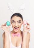 Playful young woman with Easter eggs Royalty Free Stock Image