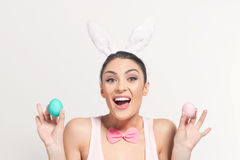 Playful young woman with Easter eggs Royalty Free Stock Photos