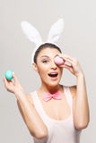 Playful young woman with Easter eggs Stock Photo