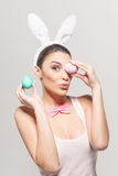 Playful young woman with Easter eggs Stock Image