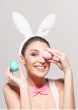 Playful young woman with Easter eggs Royalty Free Stock Photography