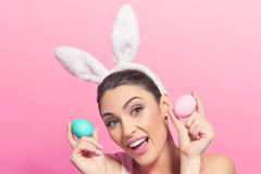 Playful young woman with Easter eggs Royalty Free Stock Photo
