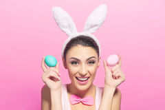 Playful young woman with Easter eggs Stock Photos
