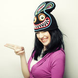 Playful young woman in funny hat with rabbit Royalty Free Stock Images