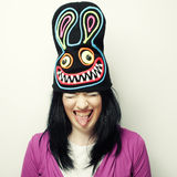 Playful young woman in funny hat with rabbit Royalty Free Stock Image