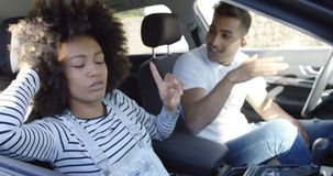 Playful young woman goofing around in a car stock footage