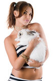 Playful young woman with rabbit Royalty Free Stock Image