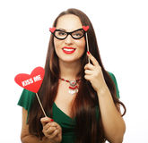 Playful young woman ready for party Stock Images