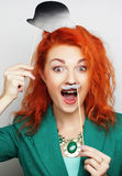 playful young woman ready for party Stock Photo