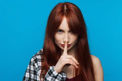 Playful young woman secrets. Gesture silent stock photo