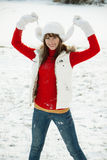 Playful young woman in winter Stock Photos