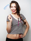 Playful young women holding a party glasses. Royalty Free Stock Photo