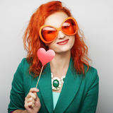 Playful young women holding a party heart Stock Images