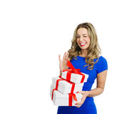 Playfull Beautiful woman with stack of gift boxes Royalty Free Stock Photos