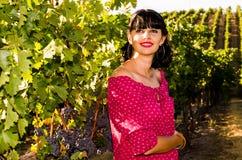 Playfull brunett i vingården Fotografering för Bildbyråer