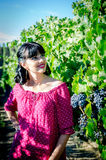 Playfull brunette in the vineyard Royalty Free Stock Photo