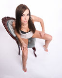 Playfull Young Brunette Woman Lace Undergarment Blue Velure Chair Stock Image