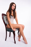 Playfull Young Brunette Woman Lace Undergarment Blue Velure Chair Royalty Free Stock Photo