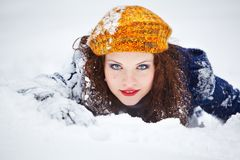 Playfull young woman in the snow Stock Images