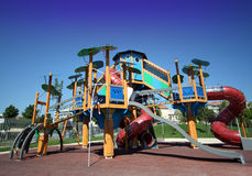 Playground. A view from a colorful playground under a beautiful clean blue sky Stock Photography