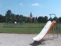 Playground. With church steeple in the distance stock photos