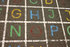 Playground. Letters of the alphabet painted on a school playground stock photo
