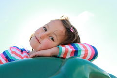 On the playground. Close up of young girl smiling at the playground stock photo